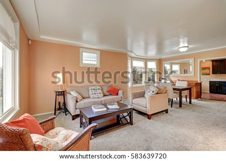 Cozy Living Room Interior With Peach Walls, Beige Sofa With Bright Pillows,  Wood Stained