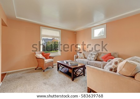 Cozy Living Room Interior With Peach Walls Beige Sofa Bright Pillows Wood Stained