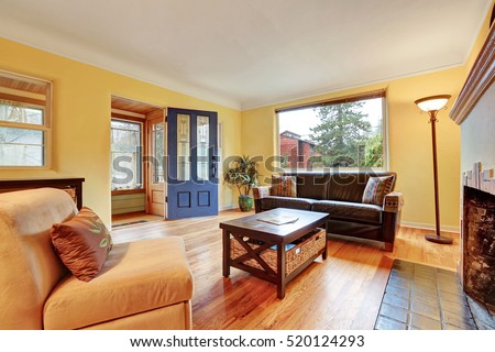 Cozy Living Room Interior With Warm Yellow Walls Fireplace And Hardwood Floor Northwest