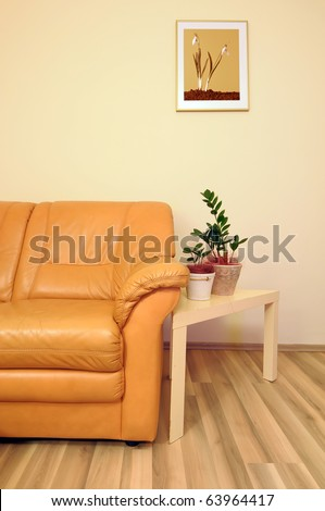 Cozy living room with comfortable leather sofa. - stock photo