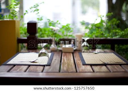 Cozy restaurant table setting - stock photo