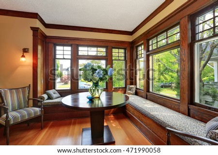 Cozy sitting area with comfortable window seats and fresh flowers on the table, Northwest, USA