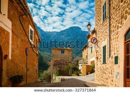 cozy stone street in the small village Deia in Mallorca, Spain - stock photo