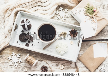 Cozy vintage toned winter holidays Christmas Composition with Gifts Boxes and Balls, Pine Cones Wooden Background. Styled photography for blog posts.