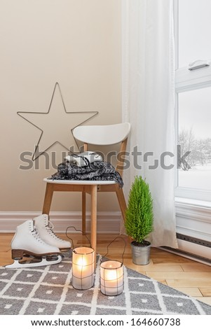 Cozy winter composition in a room, with snowy landscape seen through the window. - stock photo
