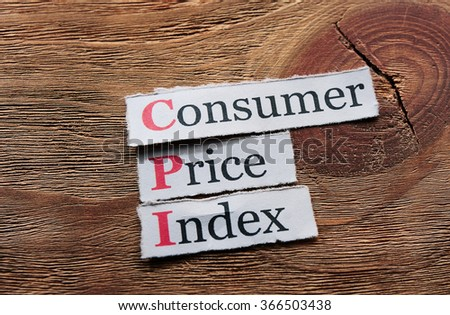 CPI - Consumer Price Index on  paper on wooden background - stock photo