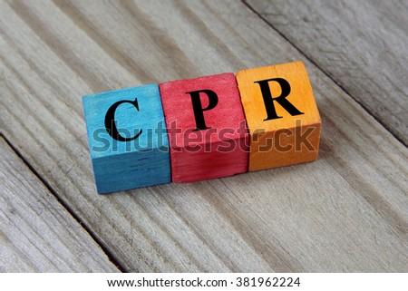 CPR (Cardiopulmonary Resuscitation) acronym on colorful wooden c - stock photo