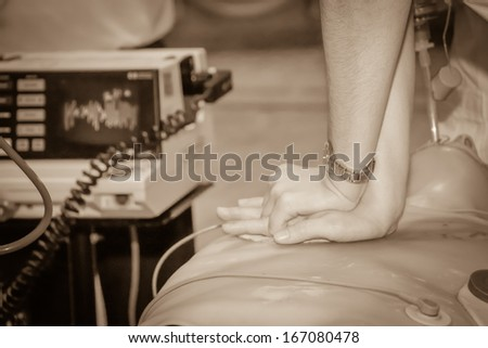CPR practice.Sepia tone - stock photo