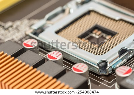 CPU Socket And Capacitors On Computer Motherboard - stock photo