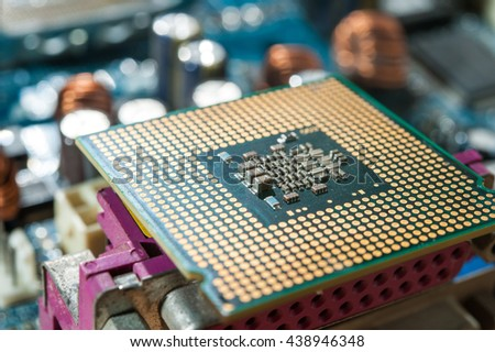 CPU socket and processor on the motherboard. Before installation processor - stock photo