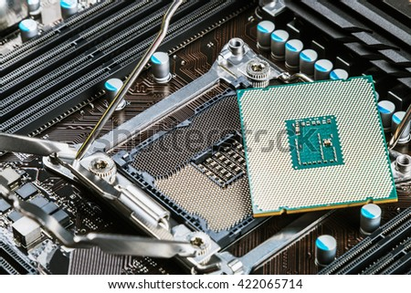CPU socket and processor on the motherboard. Focus on the motherboard - stock photo