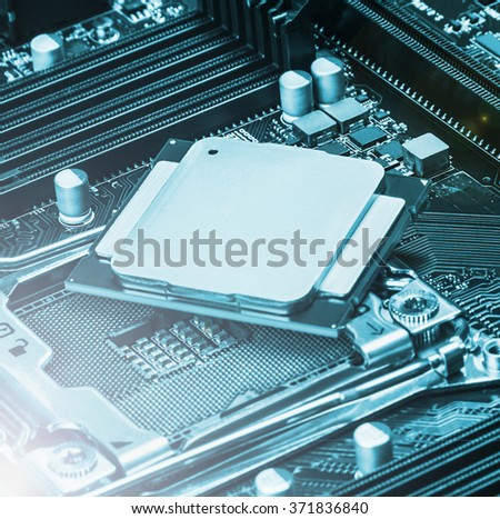 CPU socket and processor on the motherboard. focus on top of CPU. Toned image - stock photo