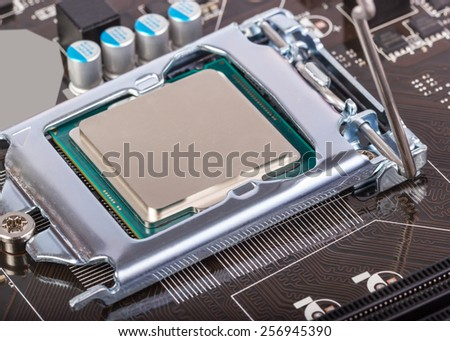 CPU socket on motherboard with installed a processor - stock photo