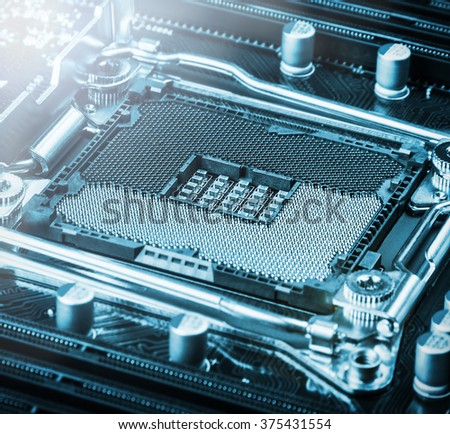 CPU socket on the motherboard. focus on CPU socket. toned image - stock photo