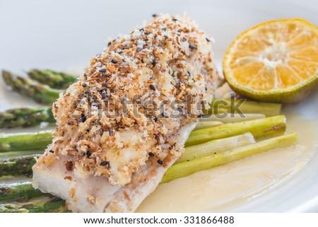 Crab and pumpkin crusted Mahi Mahi with asparagus and Calamansi butter - stock photo