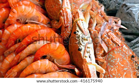 Crab and shrimp steamed sell on sea beach - stock photo