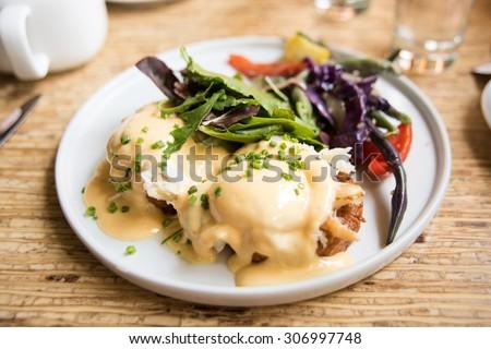 Crab and Sweet Potato Egg Benedict with Salad  - stock photo