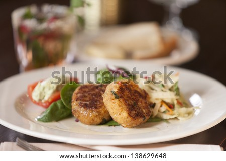 Crab cake appetizer on a white plate. - stock photo