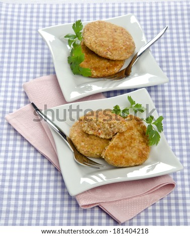 crab cakes on a white plate with parsley