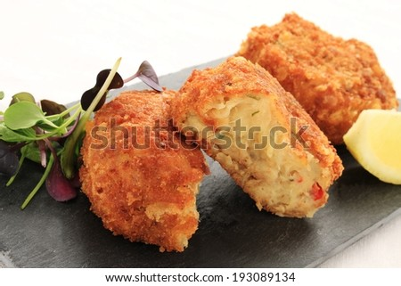 crab fish cakes on slate platter