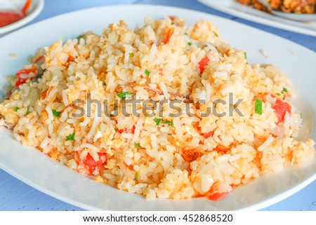 Crab fried rice: This dish contains crab, rice, tomato, egg, scallion