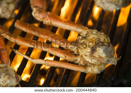 crab legs being grilled for dinner - stock photo