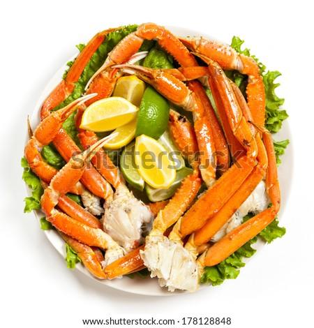 Crab legs with lemon - stock photo