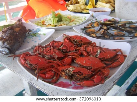 Crab platter and seafood on the boat deck - stock photo