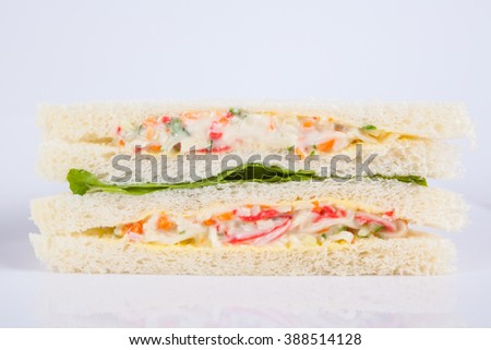 crab salad sandwich with tomato, lettuce and mayonnaise