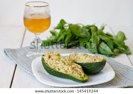 Crab salad with avocado in a glass of wine - stock photo