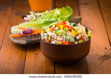 crab salad with mayonnaise on wood. - stock photo
