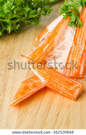 Crab Stick on wooden background.