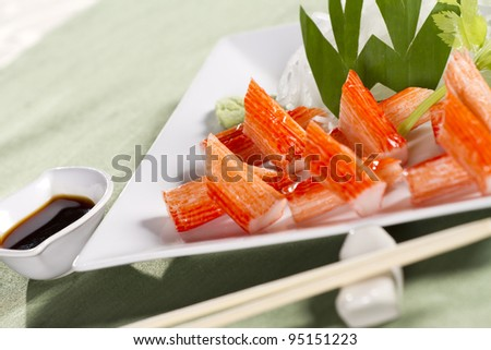 crab stick set, decorate crab stick in white plate Japanese food.