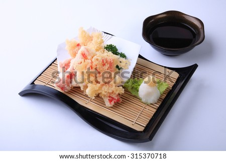 Crab stick Tempura, deep fried sliced squid in japanese dish isolated on white background. - stock photo