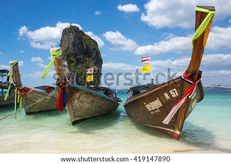 CRABI PROVINCE, THAILAND - FEBRUARY 02, 2015: Traditional thai long tail boats waiting for tourists to travel to beautiful islands in Thailand