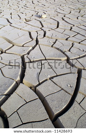 Craced clay in desert, west China - stock photo