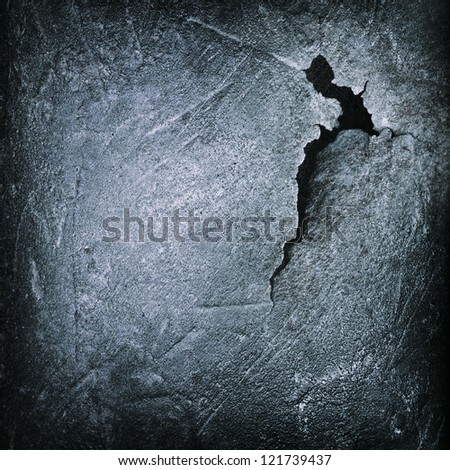 crack at black iron cast surface ; abstract grunge background