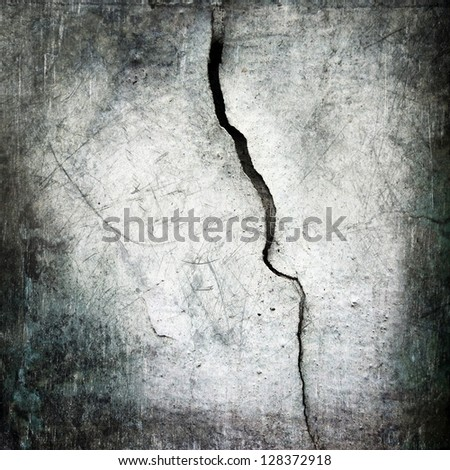 crack at scratched worn wall ;  grunge background - stock photo