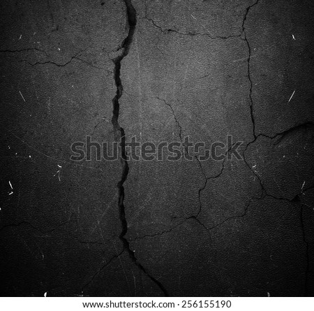 Crack black background or texture - stock photo
