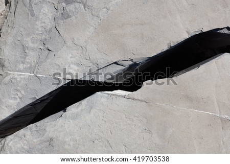 Crack in a gray stone texture background