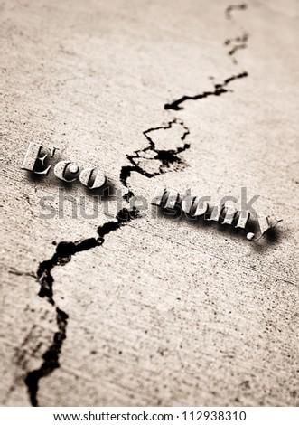 Crack in cement symbolizing a broken economy - stock photo