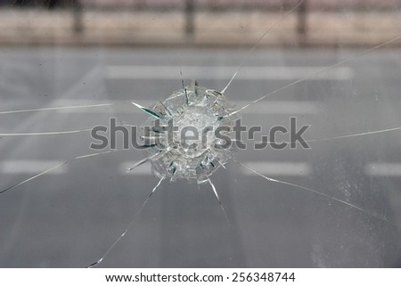 Crack in glass. Broken glass close up. - stock photo