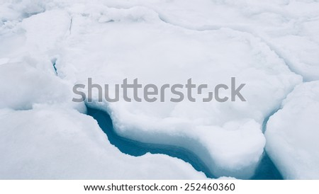 Crack in ice on sea ice in Alaska in winter. - stock photo