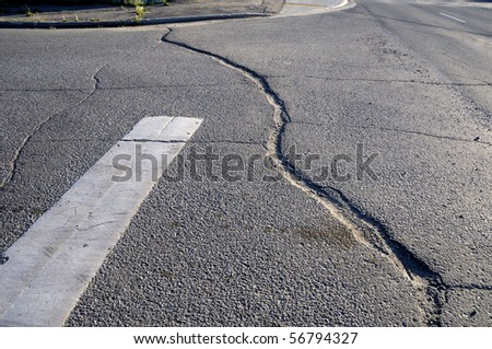 Crack in Pavement on City Street - stock photo