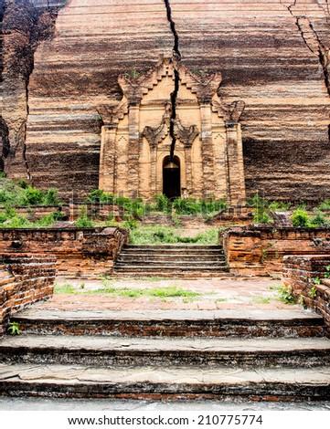 crack on the door of the unfinished Mingun pagoda, Mandalay, Myanmar - stock photo