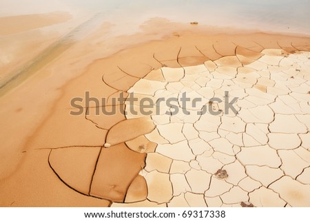 Cracked and Arid Mud Ground Dry without water - stock photo