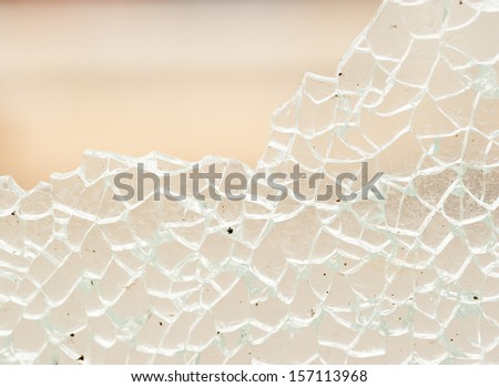 cracked and broken glass window - stock photo