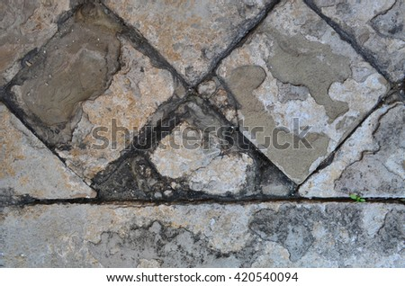 Cracked and old cement footpath for texture and background - stock photo