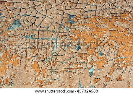Cracked and peeling paint on wood