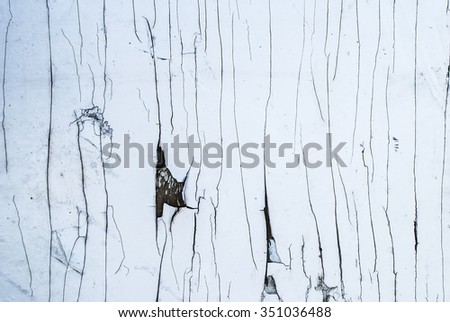 cracked and peeling white painted old wall - stock photo